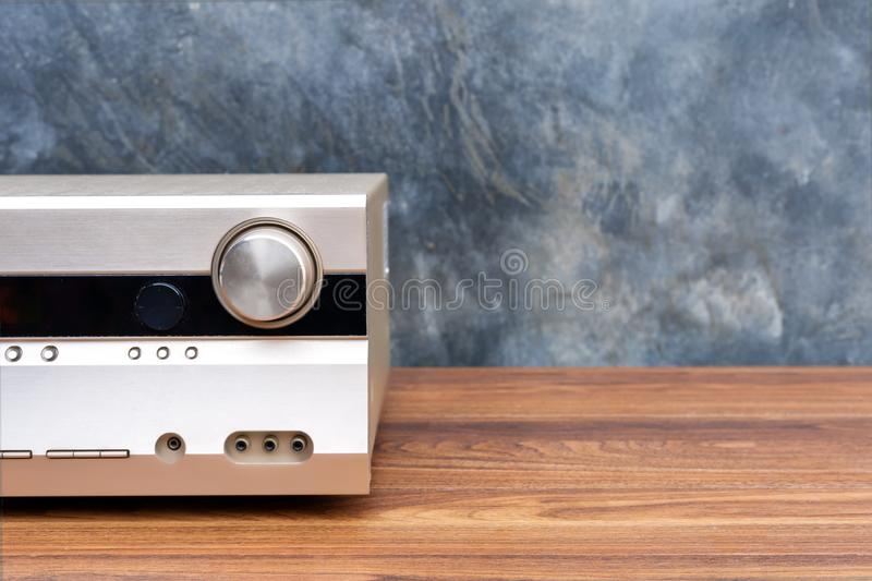 Half front side AV receiver with volume and AUX Plugin on wood table royalty free stock photos