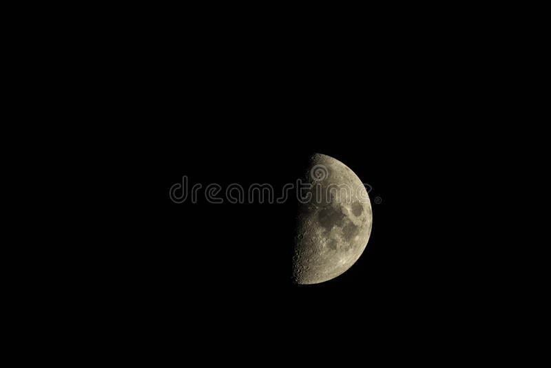 Half full moon stock images