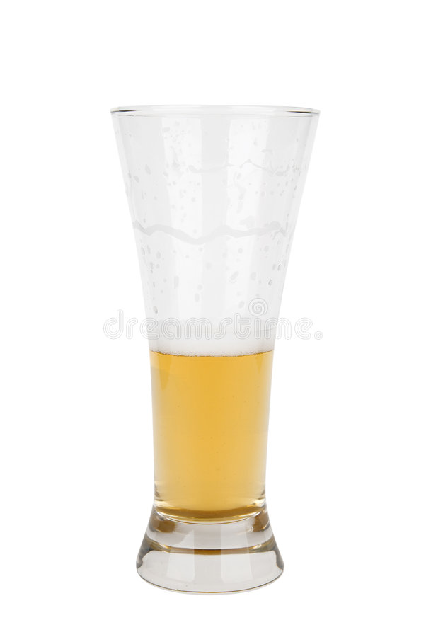 Half a glass of light beer royalty free stock photos