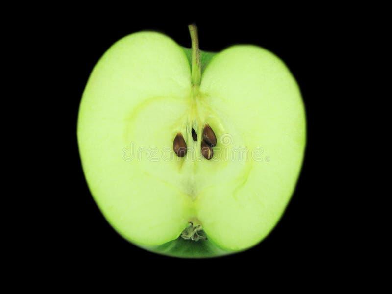 Half of the green apple. stock image