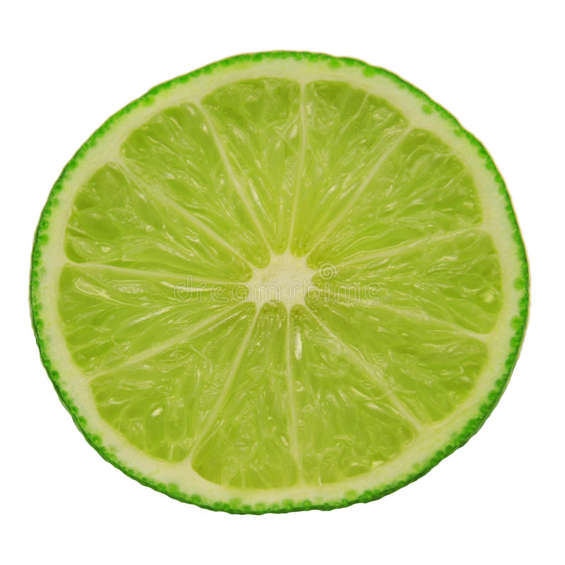 Half green lime. Green juicy lime close up on white background. Isolated stock photo