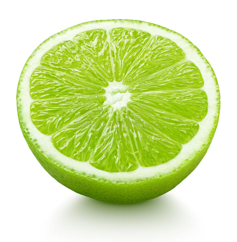 Half of green lime citrus fruit isolated on white. Ripe half of green lime citrus fruit isolated on white background with clipping path stock image