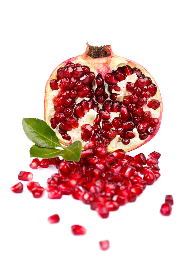 A half grenadine with seeds. Over white background stock photography