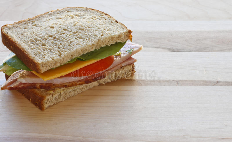 Download Half Ham And Cheese Sandwich On Wood Cutting Board Stock Image - Image: 23978607