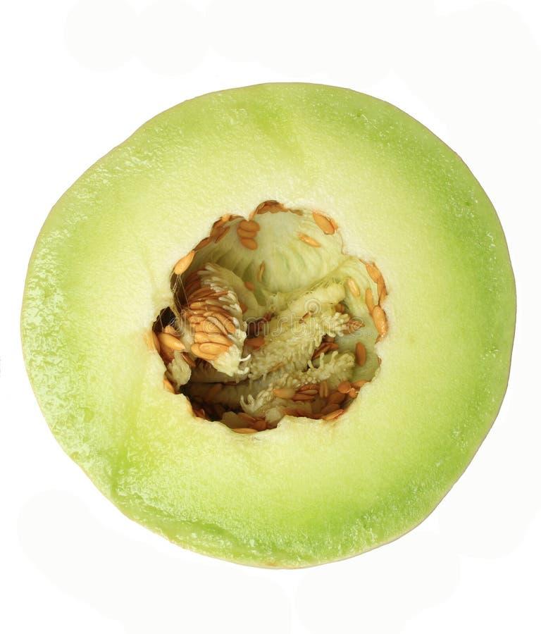 Honeydew Melon. Half fresh honeydew melon on isolated white background stock image