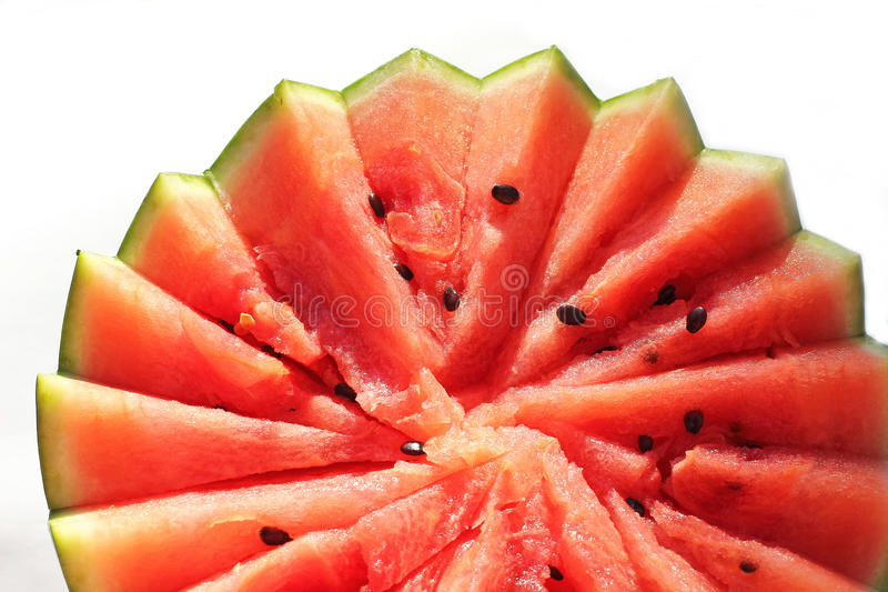 A half jagged watermelon. Isolated on white stock photo