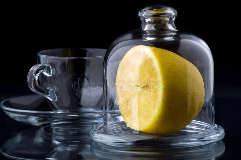 Lemon in a glass vase royalty free stock photography