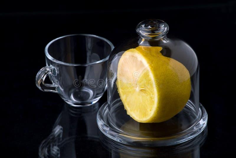 Lemon in a glass vase royalty free stock photo