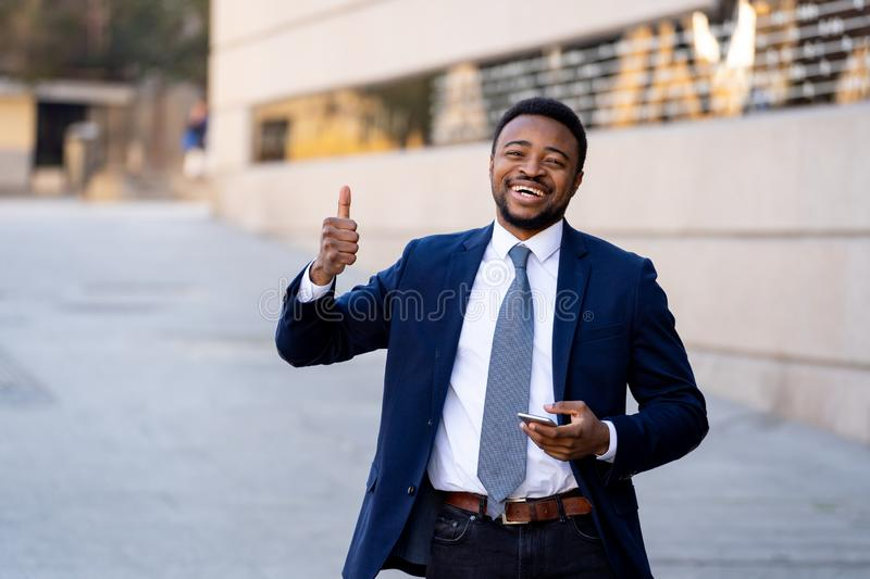 Half length portrait of an attractive stylish and successful businessman outside city street royalty free stock photos