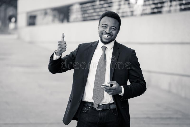 Half length portrait of an attractive stylish and successful businessman outside city street stock photo