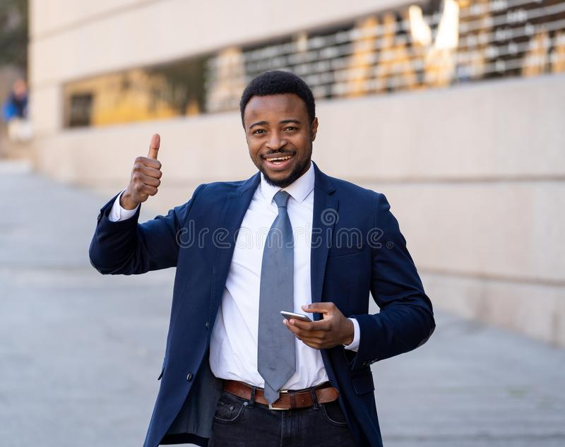 Half length portrait of an attractive stylish and successful businessman outside city street stock images