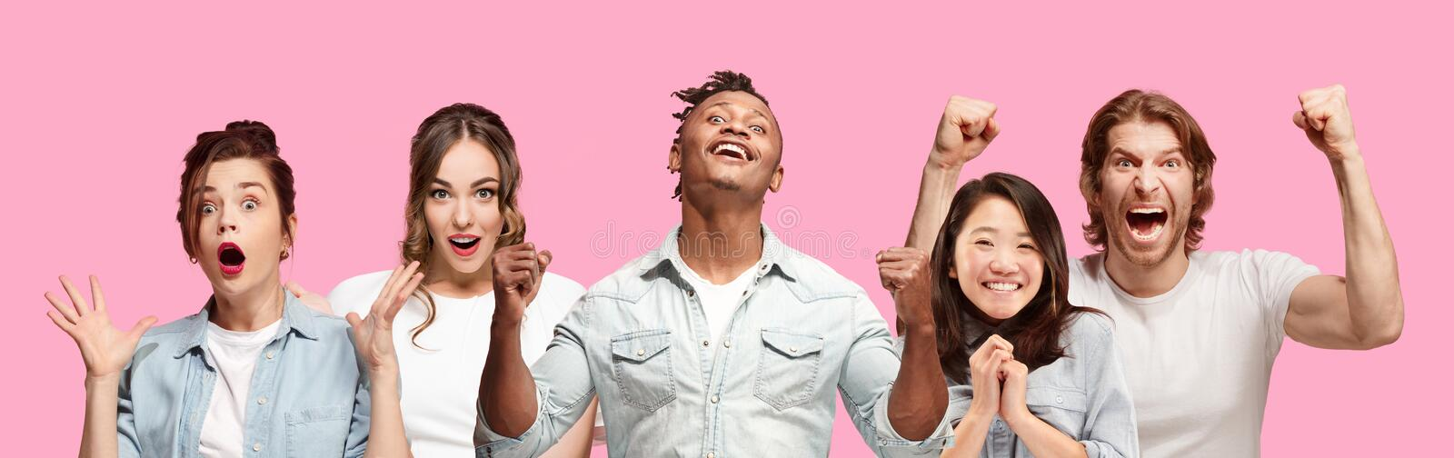 Half-length close up portrait of young people on pink background. royalty free stock photo