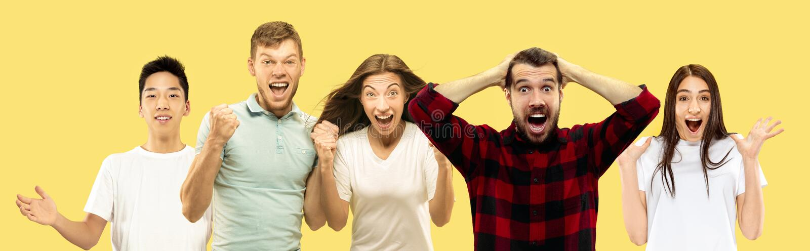 Half-length close up portrait of young people on yellow background. stock images