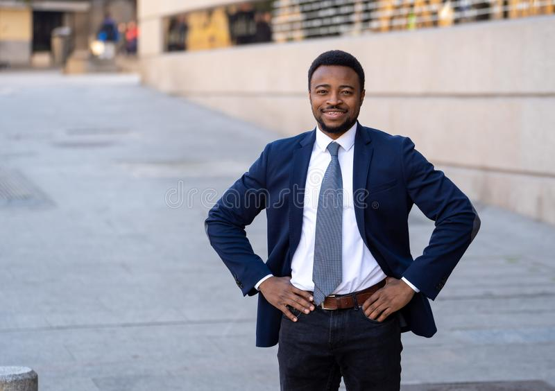 Half length portrait of an attractive stylish and successful businessman outside city street stock photography