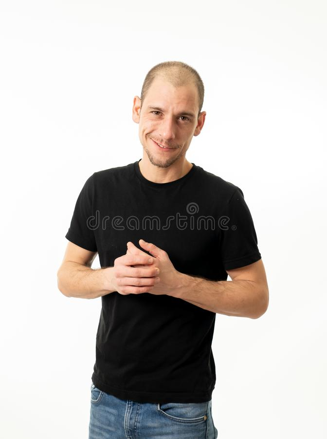 Human expressions and emotions. Young attractive man with a confident and neutral face. Half length portrait of handsome caucasian man with a neutral and royalty free stock images