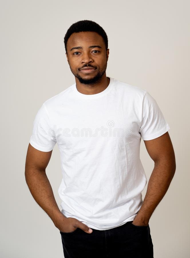 Half length portrait of handsome young man in neutral face and confident facial expressions. Portrait of attractive, confident african american young man looking royalty free stock photos