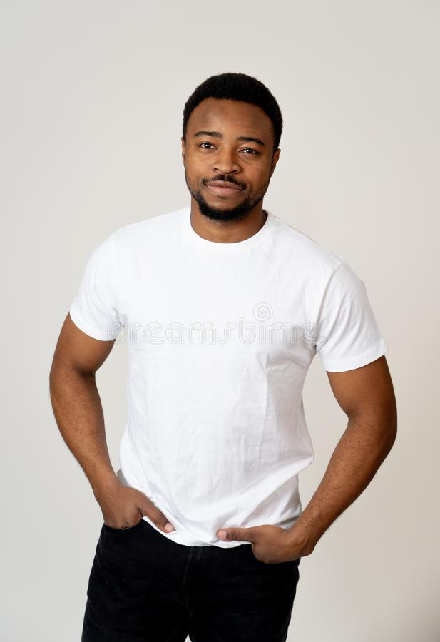 Half length portrait of handsome young man in neutral face and confident facial expressions. Portrait of attractive, confident african american young man looking stock images
