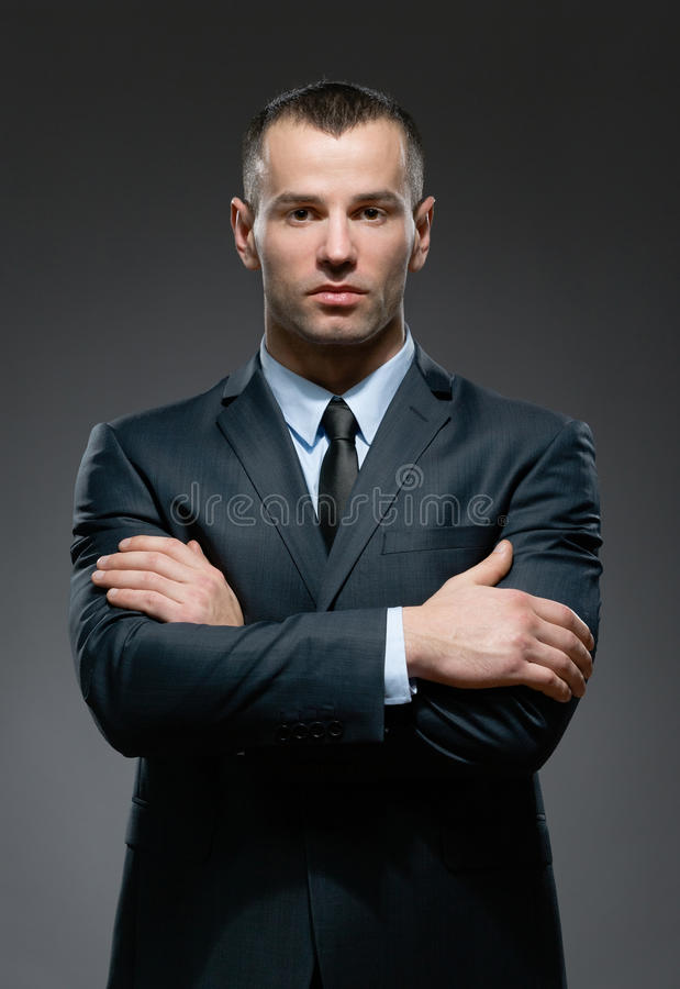 Half Length Portrait Of Manager With Crossed Arms Stock