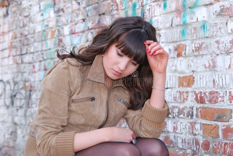 Half-length portrait of sad brunette girl. royalty free stock images