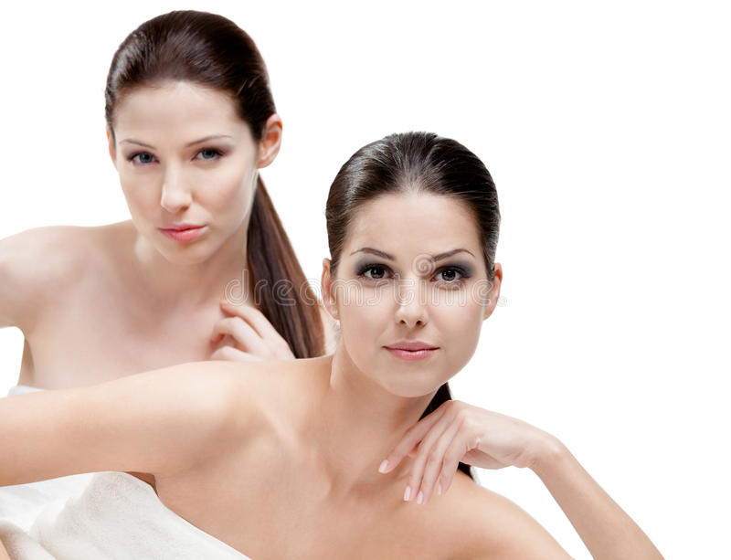 Half length portrait of two half naked women. Who are ready for beauty procedures, isolated royalty free stock photos