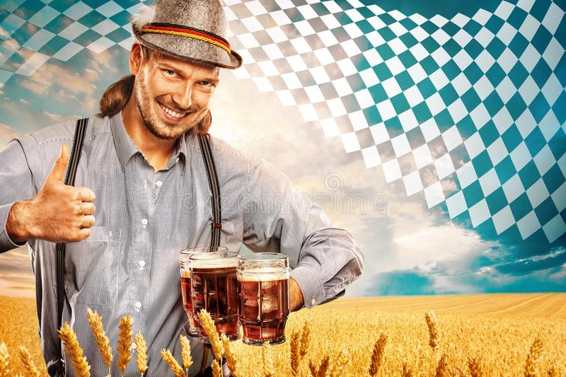 Portrait of Oktoberfest man, wearing a traditional Bavarian clothes, serving big beer mugs. royalty free stock photo