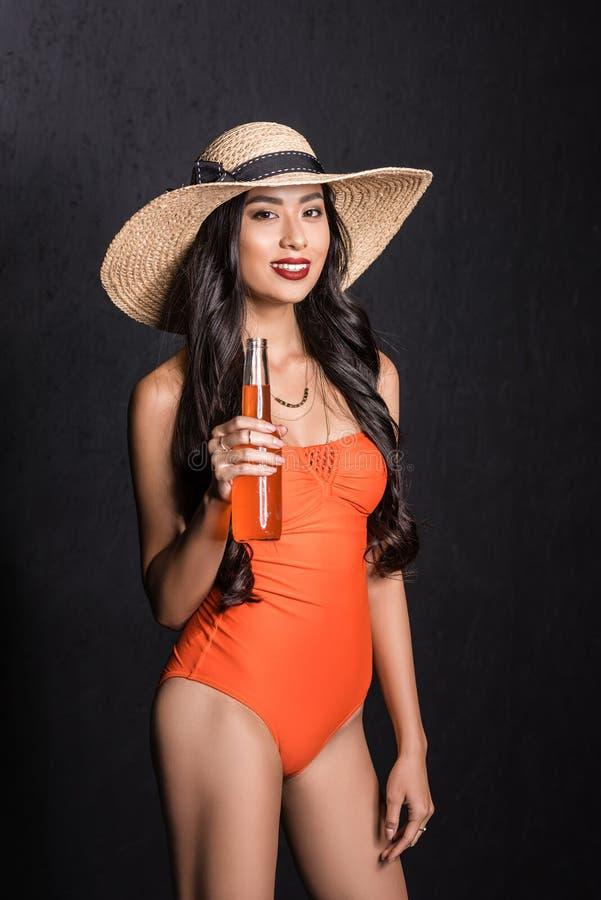 2da340ff8a367 Half-length shot of smiling asian woman royalty free stock photography
