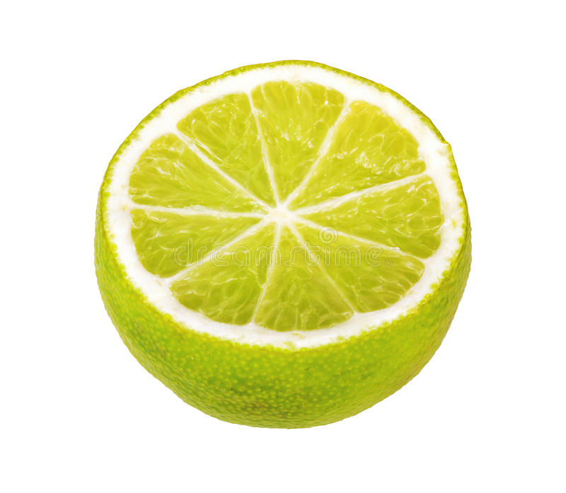 Half of lime citrus fruit isolated on white royalty free stock image
