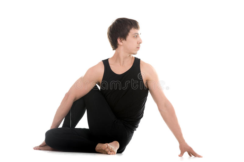 Half lord of the fishes yoga pose stock photography