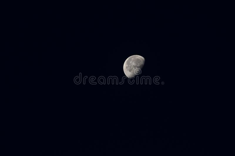 Half moon background  The Moon is an astronomical body that orbits planet Earth and is Earth`s only permanent natural satellite. I royalty free stock photography