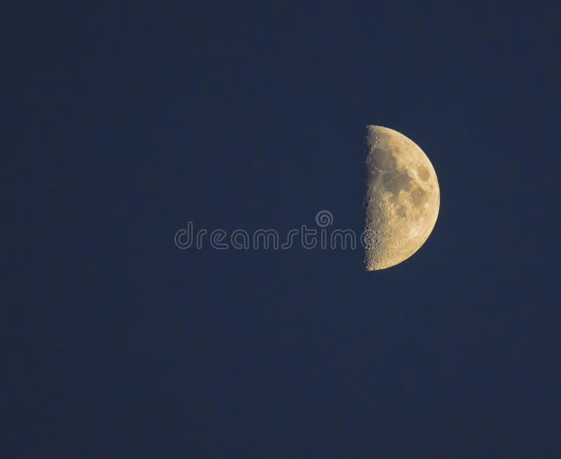 Half Moon on dark background stock photo