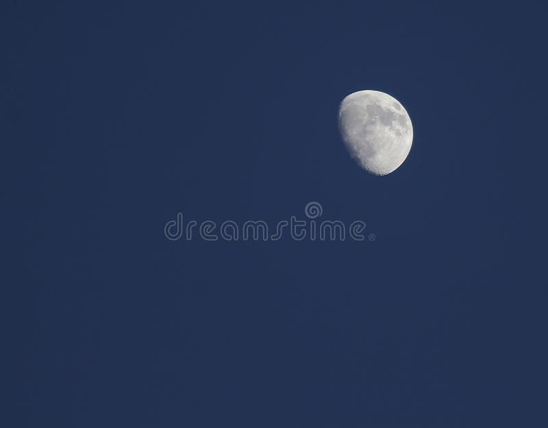 Half moon. On a dark blue background royalty free stock image
