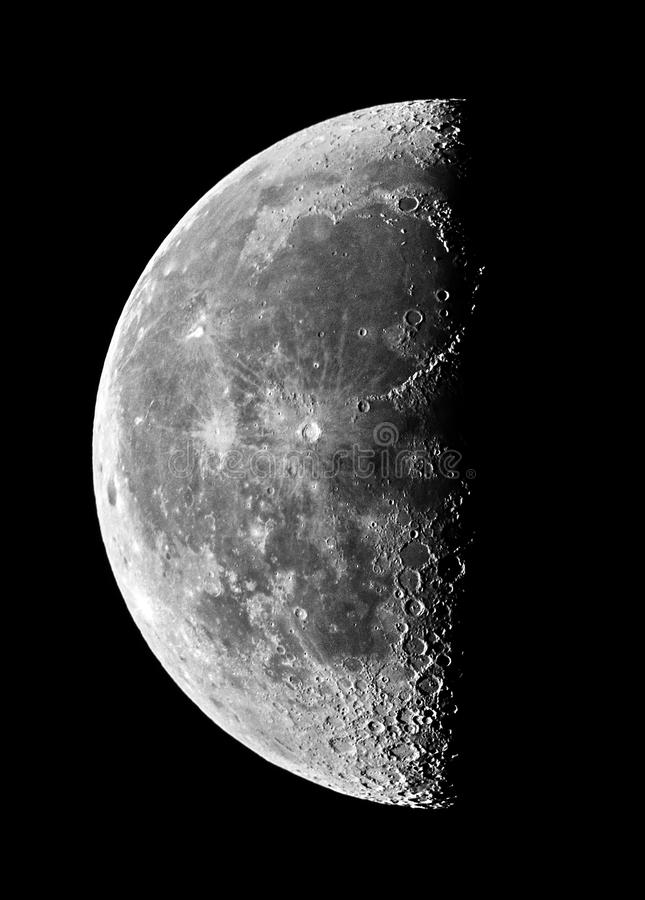 Moon details and craters night sky observing over telescope. Half moon details and craters observing royalty free stock photo