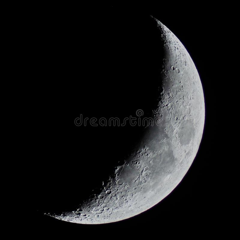Half Moon details observing over telescope stock images