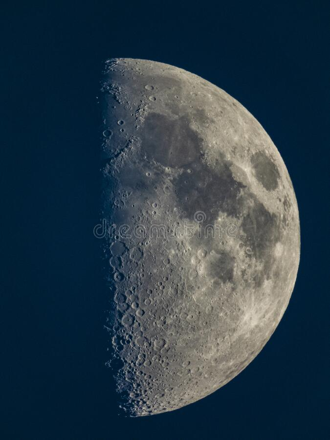 Half moon in late afternoon stock photo