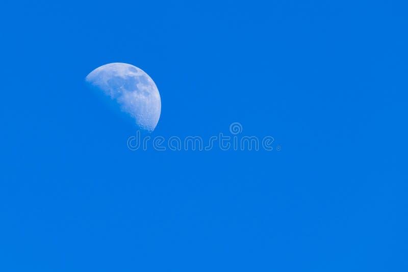 Half moon n blue day sky royalty free stock image