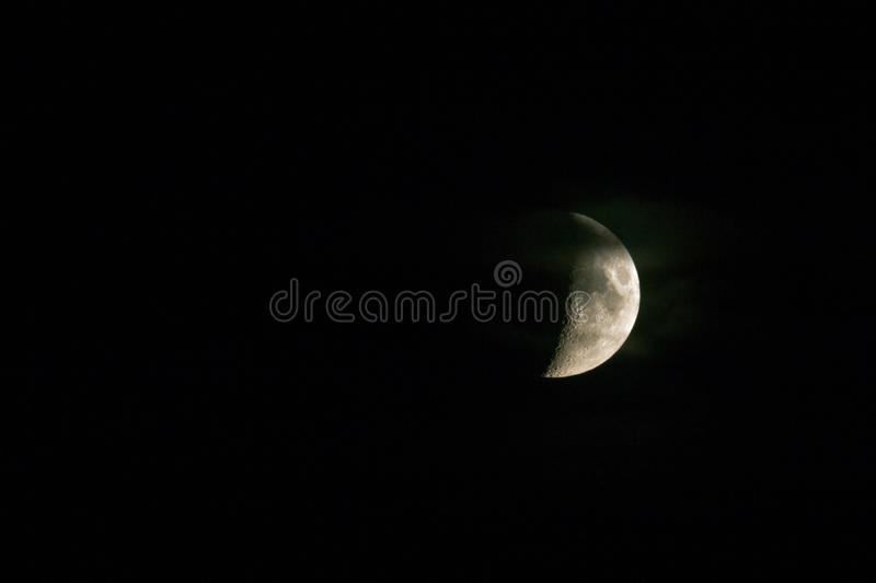 Half moon. In the night sky royalty free stock photography