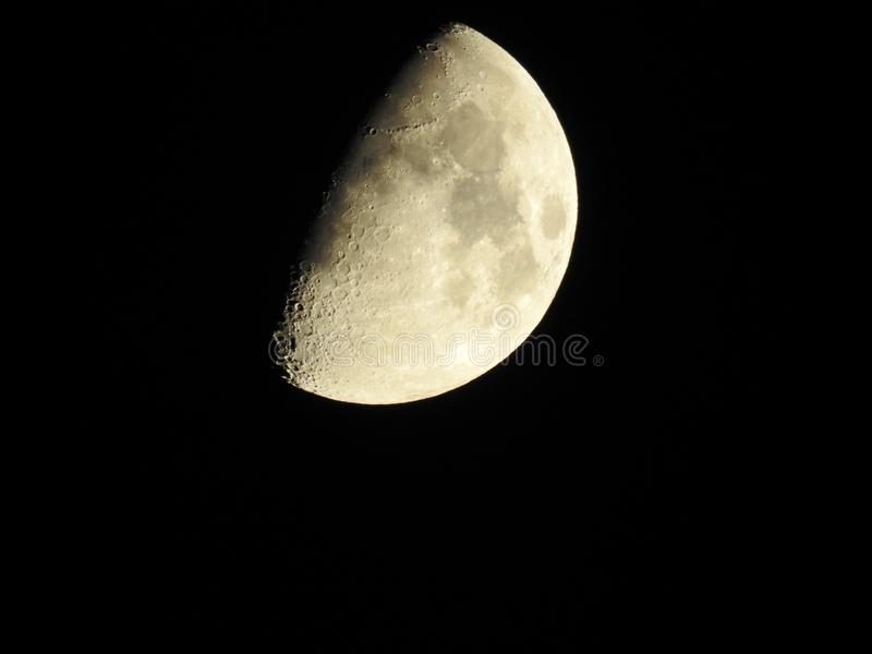 Half moon shining its light. Moonlight night creepy Halloween spells rituals were wolfs half moon space astronomy stars and moon stock photos