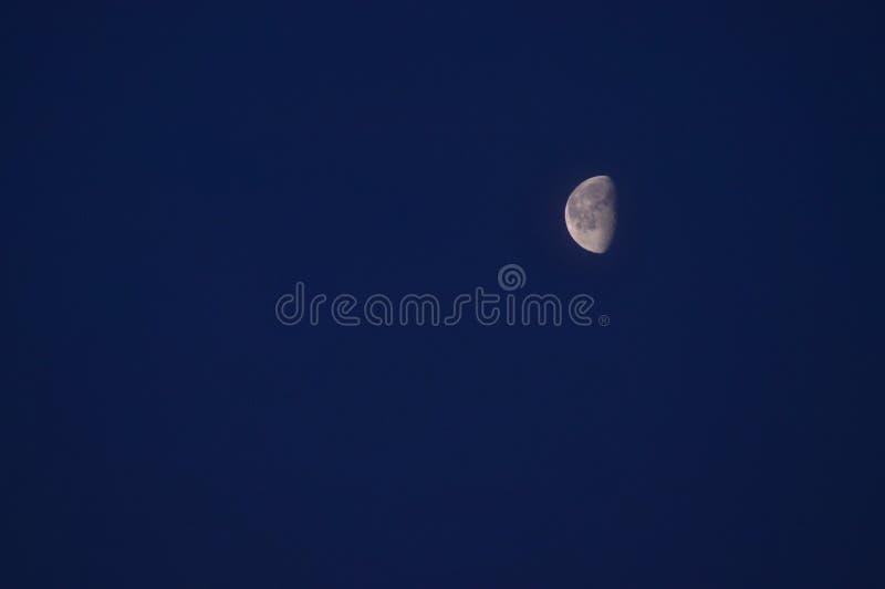 Half Moon Under Clear Blue Sky stock image