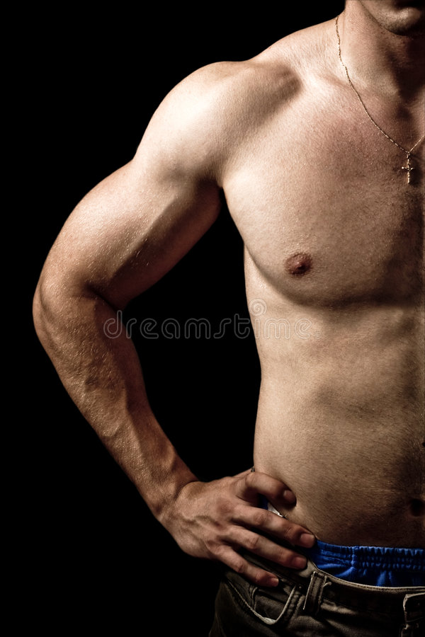 Half of muscular male body isolated on black royalty free stock image