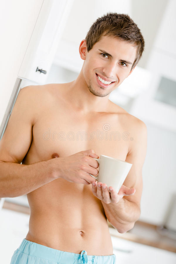 Half-naked Man With Cup Of Tea At Kitchen Royalty Free Stock Photography