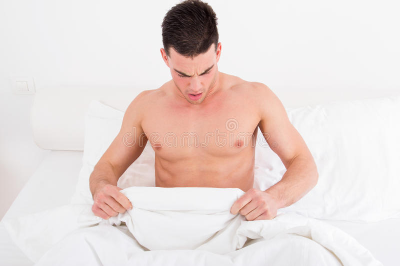 Download Half Naked Young Man In Bed  Looking Down At His Underwear Stock Photo - Image of casual, adult: 40127364