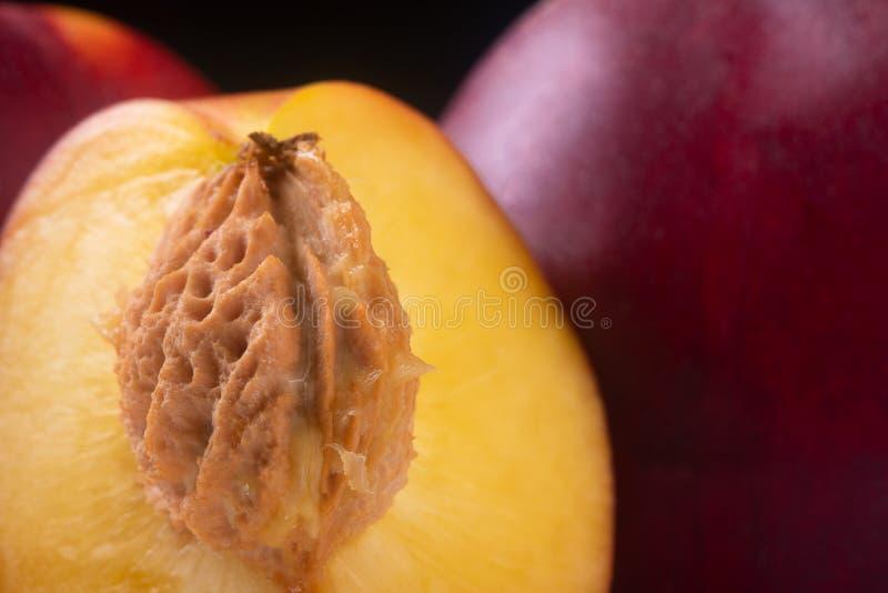 Half nectarine peaches stock images