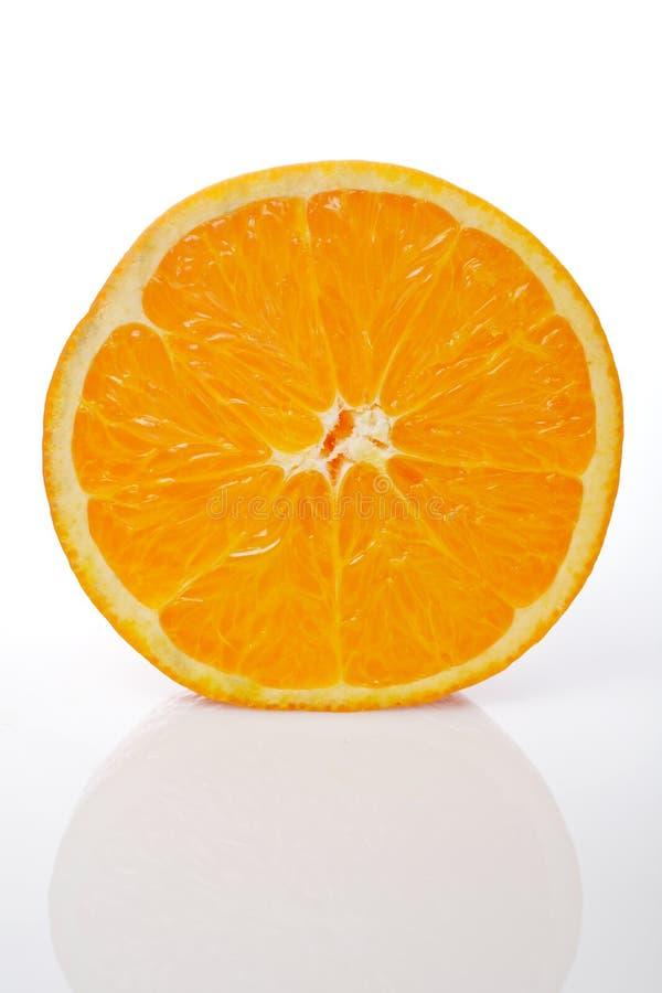 Half orange. Half an orange reflected on white background royalty free stock image