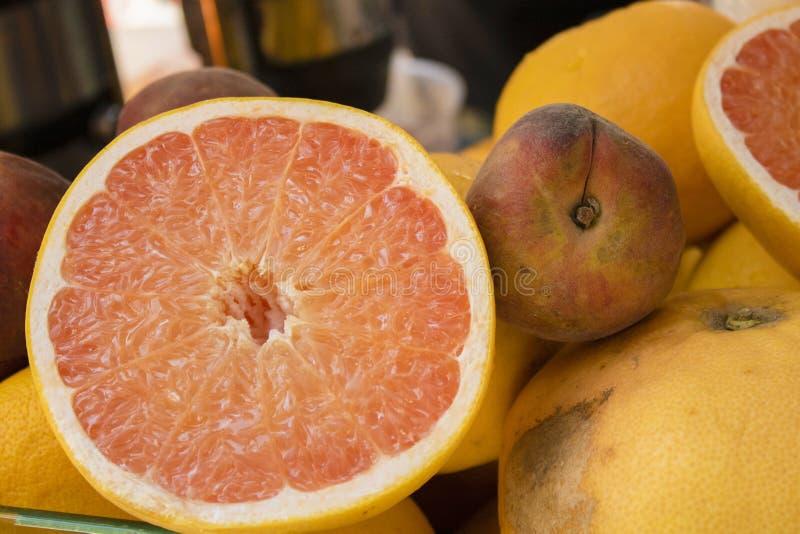 Half orange close-up. Peach beside royalty free stock photo