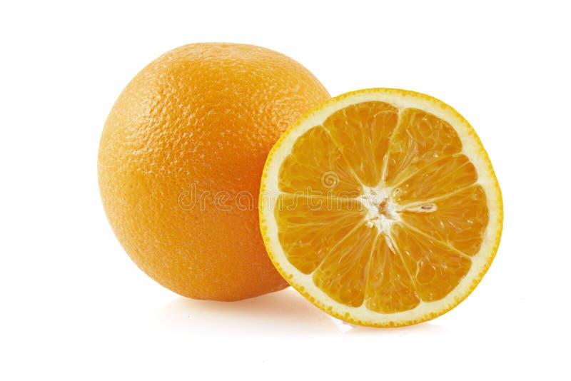 Half of orange and the orange. Half of orange and the whole orange. On white background, with reflexions stock images