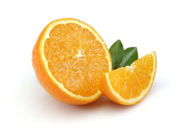 Half Orange and Orange Slice royalty free stock photography