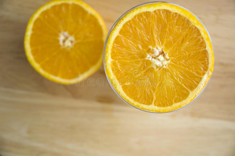 Half of orange on top. Half of fresh orange cut on top royalty free stock photos
