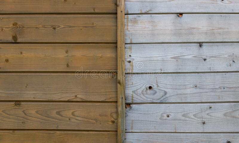 Half painted wooden yellow wall stock photo