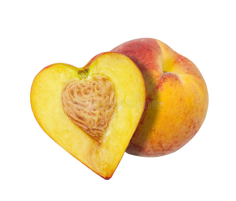 The half of the peach in the form of heart royalty free stock photography