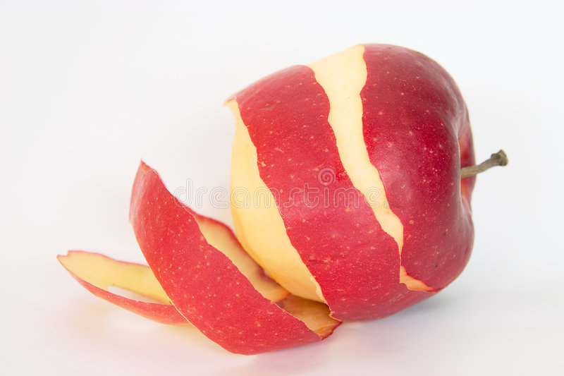 Half peeled red apple stock images